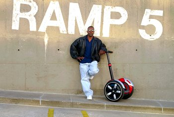 A man with his Segway HT.
